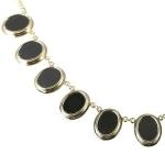 Золотое ожерелье с ониксами Мэрилин Монро