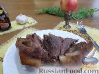 Фото к рецепту: Маринованная рулька, запеченная в духовке