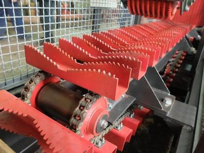 Подающий транспартер брусовального двухвального станка с гусеничной подачей мод. «KRAFTER»